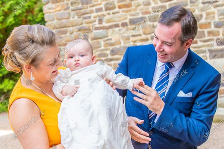 Hereditary Grand Duke Guillaume of Luxembourg and Grand Duchess Stephanie of Luxembourg with Prince Charles of Luxembourg during the christening of Prince Charles of Luxembourg, at Abbaye Saint-Maurice in Clervaux, Luxembourg.