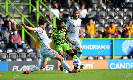 Anthony O'Connor of Bradford City tackles Ebou Adams of Forest Green Rovers