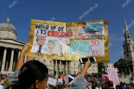 Stock Picture of People gather in Trafalgar Square during a protest against the mandatory use of face masks, the Coronavirus COVID-19 vaccine, social distancing and the mass gatherings restrictions.