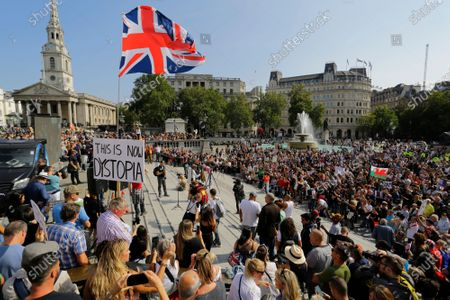 People gather in Trafalgar Square during a protest against the mandatory use of face masks, the Coronavirus COVID-19 vaccine, social distancing and the mass gatherings restrictions.