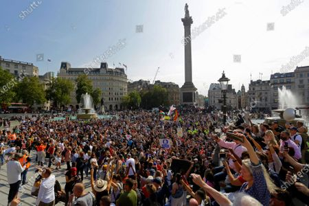 Stock Photo of People gather in Trafalgar Square during a protest against the mandatory use of face masks, the Coronavirus COVID-19 vaccine, social distancing and the mass gatherings restrictions.