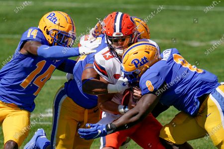 Syracuse quarterback Tommy DeVito (13) is sacked by Pittsburgh defensive lineman Calijah Kancey (8) and defensive back Marquis Williams (14) during the first half of an NCAA college football game, in Pittsburgh