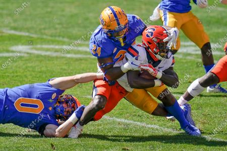 Stock Photo of Pittsburgh linebackers John Petrishen (0) and Phil Campbell III (24) tackle Syracuse's Nykeim Johnson (4) on a punt return during the second half of an NCAA college football game, in Pittsburgh