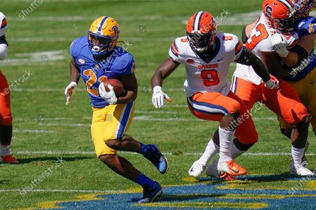 Pittsburgh running back A.J. Davis (21) runs away from Syracuse defensive lineman Kingsley Jonathan (9) during the first half of an NCAA college football game, in Pittsburgh. Pittsburgh won 21-10