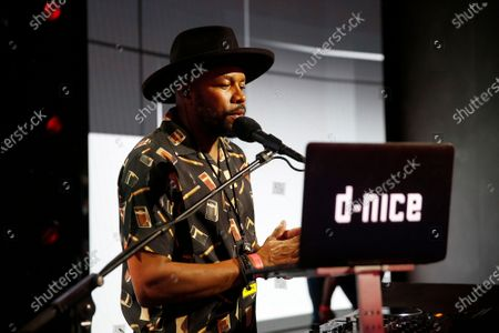 Stock Image of D-Nice known as Derrick Jones, a disc jockey, rapper producer, left, sets up his table with production onstage during rehearsals Friday for the 72nd Annual Emmy Awards taking place at Staples Center this Sunday. Staples Center on Friday, Sept. 18, 2020 in Los Angeles, CA. (Al Seib / Los Angeles Times