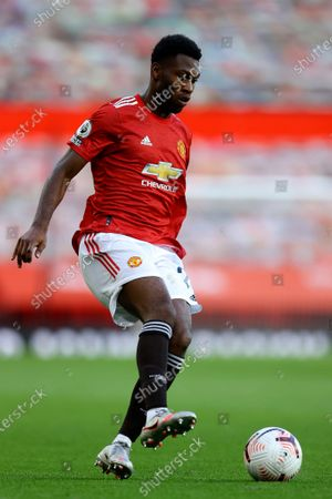 Manchester United's Timothy Fosu-Mensah controls the ball during the English Premier League soccer match between Manchester United and Crystal Palace at the Old Trafford stadium in Manchester, England