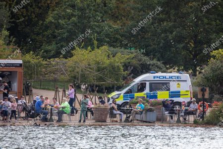 Members of the public enjoy the Serpentine on a pedalo as Police patrol Hyde Park in London on the first weekend of the Rule of Six where gatherings of over six people have now been banned by the Government after a spike in coronavirus cases. Prime Minister Boris Johnson announced yesterday that the UK was heading for a second wave with the North East already under lockdown.