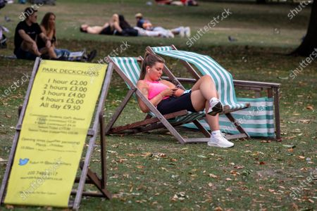 A sunbather enjoys the warm sunshine on the first weekend of the Rule of Six as Police patrol Hyde Park in London. Gatherings of over six people have now been banned by the Government after a spike in coronavirus cases. Prime Minister Boris Johnson announced yesterday that the UK was heading for a second wave with the North East already under lockdown.