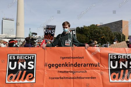 People march during a demonstration against child poverty in Berlin, Germany, 19 September 2020.