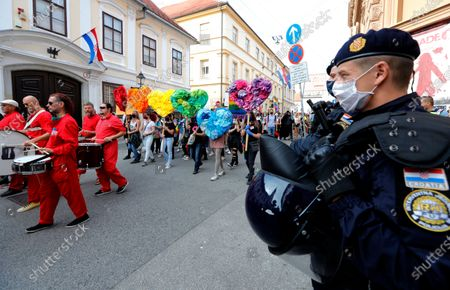 Activists and supporters of the LGBT (lesbian, gay, bisexual, and transgender persons) movement attend a Gay Pride march in Zagreb, Croatia, 19 September 2020. The Pride march was attended by thousands of people.