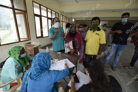 Editorial photo of Medical Team Conducts COVID-19 Coronavirus Test, Gurugram, Haryana, India - 19 Sep 2020