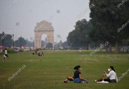 Stock Photo of People seen at India Gate on a pleasant day, on September 19, 2020  in New Delhi, India.