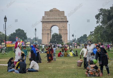 Stock Picture of People seen at India Gate on a pleasant day, on September 19, 2020  in New Delhi, India.