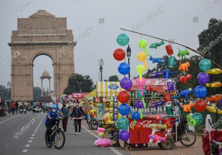 Stock Image of People seen at India Gate on a pleasant day, on September 19, 2020  in New Delhi, India.