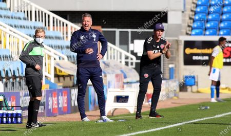 Peterborough United Manager Darren Ferguson watches on alongside Fleetwood Town manager Joey Barton