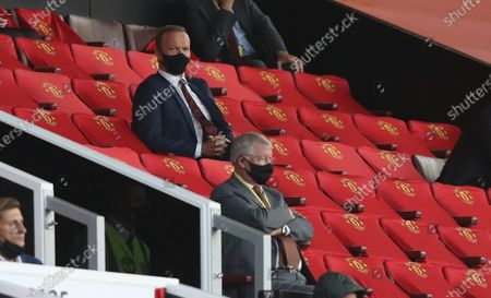 Executive vice-chairman of Manchester United Ed Woodward (up) and Sir Alex Ferguson watch during the English Premier League match between Manchester United and Crystal Palace in Manchester, Britain, 19 September 2020.