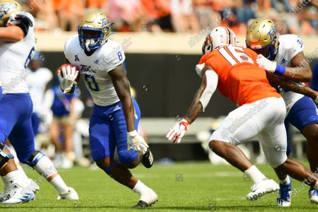 Tulsa running back Deneric Prince (8) carries the ball past Oklahoma State linebacker Devin Harper (16), who is blocked by Tulsa tight end James Palmer (32), in the second half of an NCAA college football game, in Stillwater, Okla