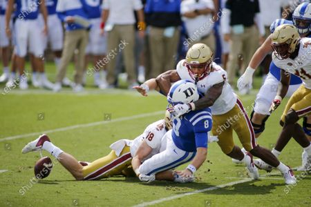 Boston College defensive back Deon Jones (5) forces Duke Blue quarterback Chase Brice (8) to fumble as Boston College defensive back Mike Palmer helps to make the tackle during the second half of an NCAA college football game, in Durham, N.C