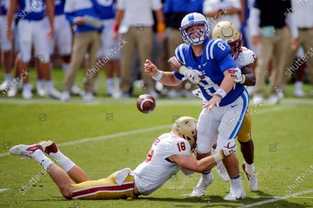 Stock Image of Boston College defensive back Deon Jones (5) forces Duke Blue quarterback Chase Brice (8) to fumble as Boston College defensive back Mike Palmer helps to make the tackle during the second half of an NCAA college football game, in Durham, N.C