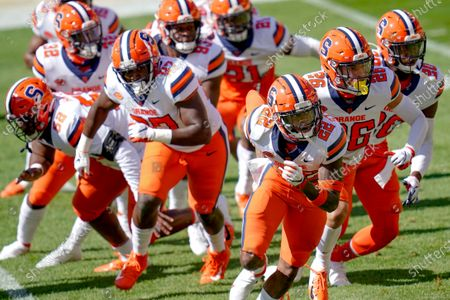 Syracuse defensive back Aman Greenwood (26) leads others through a drill as they warmup before an NCAA college football game against Pittsburgh, in Pittsburgh