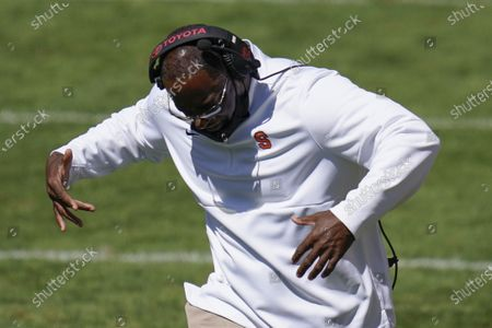 Syracuse head coach Dino Babers yells to his team as they play against Pittsburgh during the second half of an NCAA college football game, in Pittsburgh