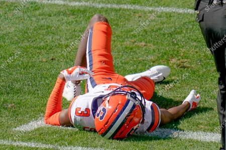 Syracuse wide receiver Taj Harris (3) lays on the field after being injured during the second half of an NCAA college football game against Pittsburgh, in Pittsburgh