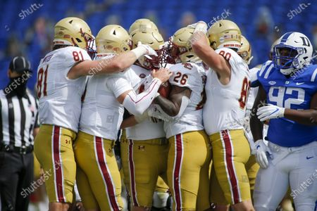 Boston College running back David Bailey (26) celebrates with teammates after rushins for a touchdown against Duke during the first half of an NCAA college football game, in Durham, N.C