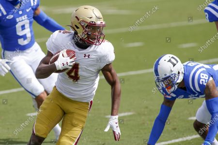 Boston College wide receiver Zay Flowers (4) runs past Duke Blue Devils cornerback Mark Gilbert (28) after a catch during the first half of an NCAA college football game, in Durham, N.C