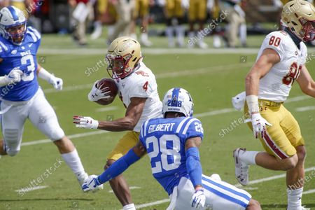 Boston College wide receiver Zay Flowers (4) runs after a catch as Duke Blue cornerback Mark Gilbert (28) tries to make the tackle during the first half of an NCAA college football game, in Durham, N.C