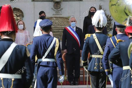 The President of Chile, Sebastian Piñera (C), and the First Lady Cecilia Morel (L) take part in the Day of the Glories of the Army ceremony, at the Libertador Bernardo O'Higgins Military School, in Santiago, Chile, 19 September 2020. Chile celebrated this 19 September the Day of the Glories of the Army emphasizing the assistance work that the Armed Forces are carrying out during the pandemic, in a smaller event that did not have the usual troop parade due to the protocols and health security measures amid the COVID-19.