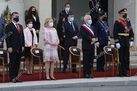 Stock Picture of The president of Chile, Sebastian Pinera (Front 2-R), takes part in the Day of the Glories of the Army ceremony along with the First Lady, Cecilia Morel (Front 2-L), the Minister of National Defense, Mario Desbordes (L), and the Commander in Chief of the Army, Ricardo Martinez (R), at the Libertador Bernardo O'Higgins Military School, in Santiago, Chile, 19 September 2020. Chile celebrated this 19 September the Day of the Glories of the Army emphasizing the assistance work that the Armed Forces are carrying out during the pandemic, in a smaller event that did not have the usual troop parade due to the protocols and health security measures amid the COVID-19.