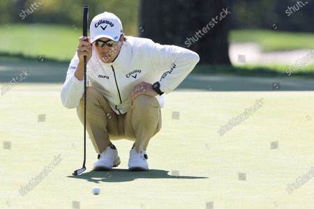 Stock Picture of Ryo Ishikawa of Japan lines up his putt during the third round of the 2020 US Open at Winged Foot Golf Club in Mamaroneck, New York, USA, 19 September 2020. The 2020 US Open will be played from 17 September through 20 September in front of no fans due to the ongoing coronovirus pandemic.