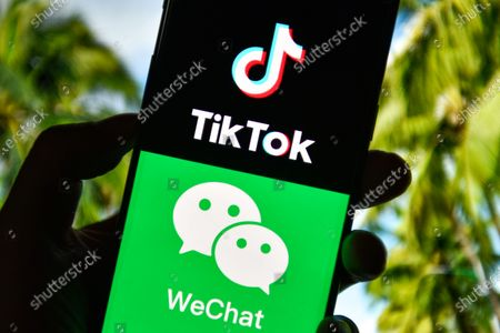 Stock Photo of In this photo illustration the TikTok and WeChat logos are seen displayed on a smartphone.