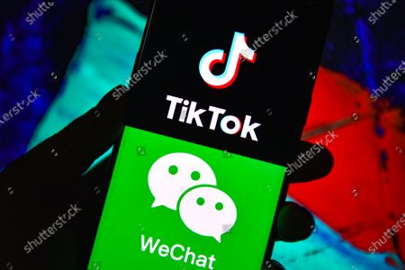 In this photo illustration the TikTok and WeChat logos are seen displayed on a smartphone.