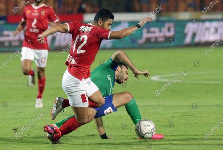 Al-Ahly's Ayman Ashraf (L) in action against Misr Makkasa's Ahmed Mohsen (R) during the Egyptian Premier League soccer match between Al Ahly SC and Misr Lel Makkasa SC in Cairo, Egypt, 19 September 2020.
