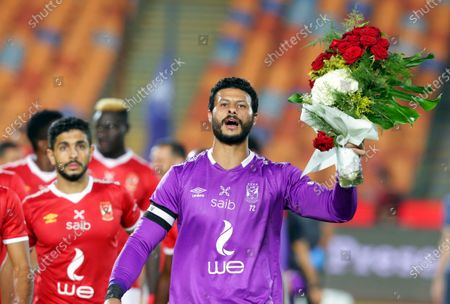 Al-Ahly's goalkeeper Mohamed El Shenawy (R) celebrates his team's 42nd Egyptian League title prior to the Egyptian Premier League soccer match between Al Ahly SC and Misr Lel Makkasa SC in Cairo, Egypt, 19 September 2020.