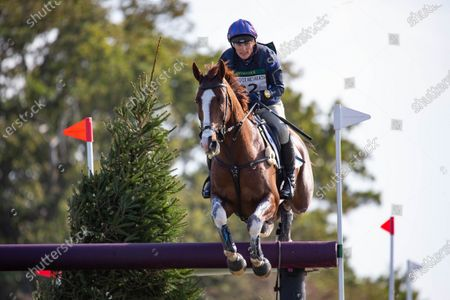 Stock Photo of Zara Tindall rides the Cross Country Course at Burnham Market Horse Trials