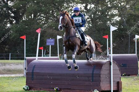 Stock Picture of Zara Tindall rides the Cross Country Course at Burnham Market Horse Trials