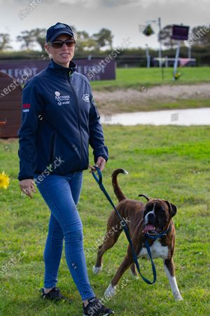 Zara Tindall walks the dog and the course at Burnham Market Horse Trials