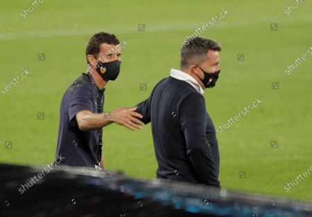 Celta's head coach Oscar Garcia (R) greets Valencia CF's head coach Javier Gracia (L) before the Spanish LaLiga Primera Division soccer match played at Balaidos stadium, in Vigo, Spain, 19 September 2020.