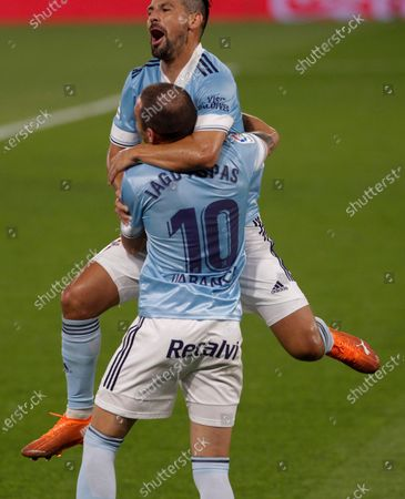 Celta's striker Iago Aspas (front) celebrates with Nolito (up) after scoring the opening goal against Valencia CF during the Spanish LaLiga Primera Division soccer match played at Balaidos stadium, in Vigo, Spain, 19 September 2020.