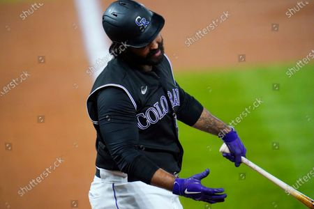 Stock Photo of Colorado Rockies' Matt Kemp reacts after striking out against Los Angeles Dodgers starting pitcher Clayton Kershaw (22) to end the fifth inning of a baseball game, in Denver