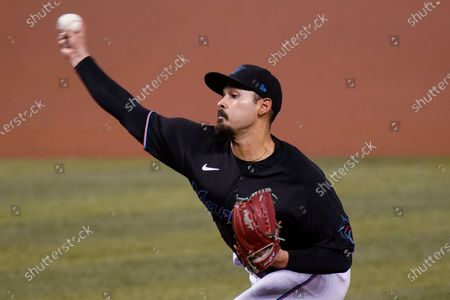 Miami Marlins starting pitcher Pablo Lopez throws during the first inning of the team's baseball game against the Washington Nationals, in Miami