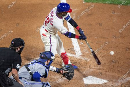 Philadelphia Phillies Andrew McCutchen (22) hits an RBI single during the fifth inning of a baseball game against the Toronto Blue Jays, in Philadelphia