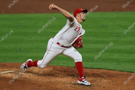 Stock Image of Cincinnati Reds' Trevor Bauer throws in the third inning during a baseball game against the Chicago White Sox in Cincinnati