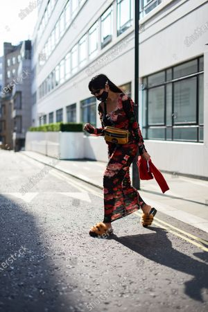 Editorial picture of Street Style, Spring Summer 2021, London Fashion Week, UK - 19 Sep 2020