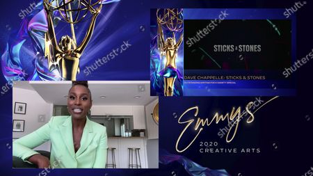 "Issa Rae presents the Emmy for Outstanding Writing For A Variety Special to Dave Chappelle for ""Dave Chappelle: Sticks & Stones"" during the 2020 Creative Arts Emmy Awards telecast on at 8:00 PM EDT/5:00 PM PDT on FXX"