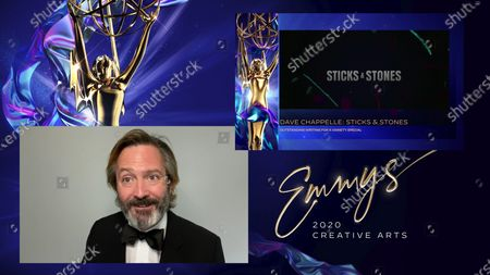 "Stock Picture of Thomas Lennon presents the Emmy for Outstanding Directing for a Variety Special to Stan Lathan for ""Dave Chappelle: Sticks & Stones"" during the 2020 Creative Arts Emmy Awards telecast on at 8:00 PM EDT/5:00 PM PDT on FXX"