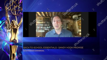 """Henry Alex Rubin of SMUGGLER, BBDO New York, accepts the Emmy for Outstanding Commercial for """"Back-to-School Essentials - Sandy Hook Promise"""" during the 2020 Creative Arts Emmy Awards telecast on at 8:00 PM EDT/5:00 PM PDT on FXX"""
