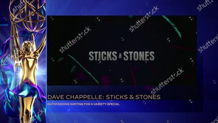"""Dave Chappelle accepts the Emmy for Outstanding Writing For A Variety Special for """"Dave Chappelle: Sticks & Stones"""" during the 2020 Creative Arts Emmy Awards telecast on at 8:00 PM EDT/5:00 PM PDT on FXX"""